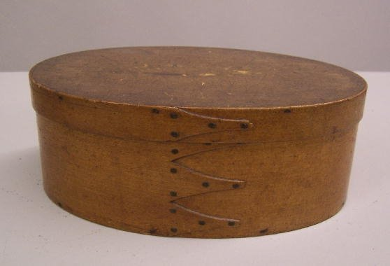 329: SHAKER OVAL BENTWOOD BOX. Old finish with a thin c