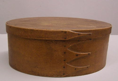 330: SHAKER  OVAL BENTWOOD BOX. Old golden brown surfac