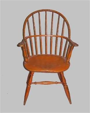 SACK BACK WINDSOR ARMCHAIR. Old pumpkin colored pa