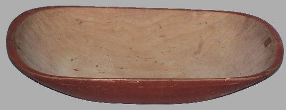 HAND HEWN TRENCHER. Birch with a worn red paint on