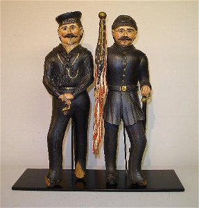 419: TWO CARVED MILITARY FIGURES. Wooden figures of a C