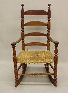 EARLY LADDER BACK ROCKER. Mixed hardwoods with an