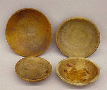 FOUR TREENWARE BOWLS. Turned wooden bowls with goo