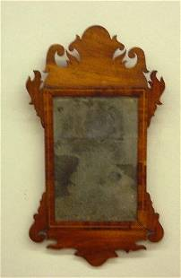 CHIPPENDALE SCROLL MIRROR. Refinished mahogany and