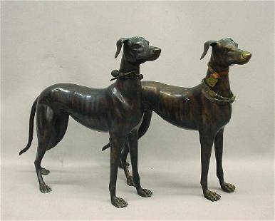 PAIR OF BRASS STANDING DOGS. Hollow body whippets