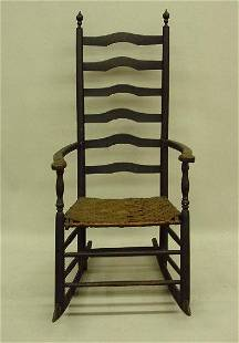 LADDER BACK ARMCHAIR ROCKER. Attributed to the coa