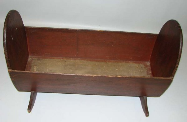 21: CRADLE WITH RED WASH.