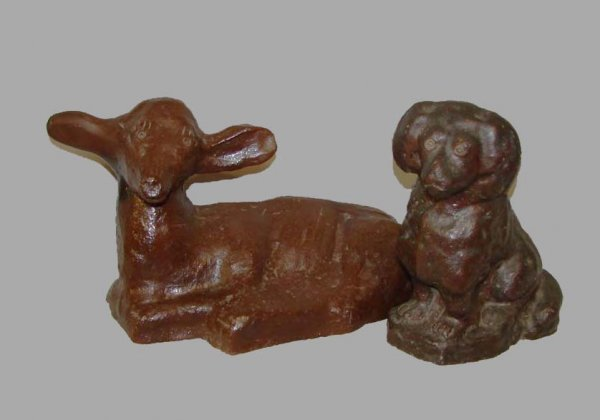 23: TWO SEWERTILE ANIMALS.