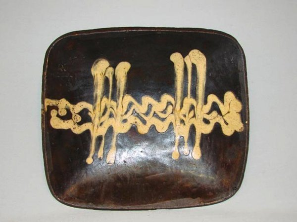 274: LOAF PAN. 19th Century. Yellow clay with manganese