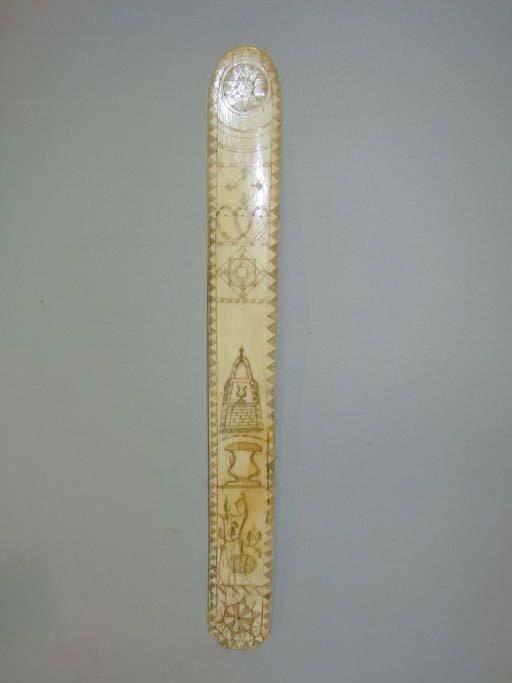 520: SCRIMSHAW BUSK. New England, 19th Century. Bone bu