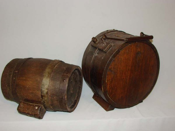 528: TWO WOODEN CASKS. 19th Century. Both are stave con