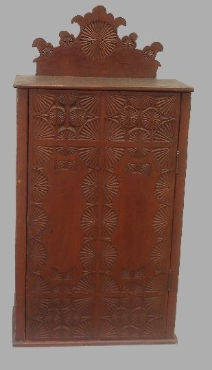 333: UNUSUAL CARVED HANGING CUPBOARD. Pine with the ori