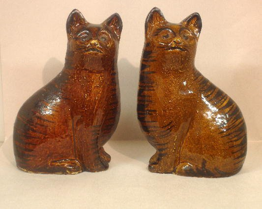 341: PAIR OF ENGLISH WHITE CLAY SEATED CATS. Brown glaz