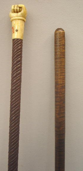 345: TWO WALKING STICKS. Spiral turned shaft with an iv