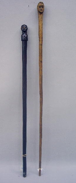 347: TWO FOLK ART CANES. Wood with carved handles in th