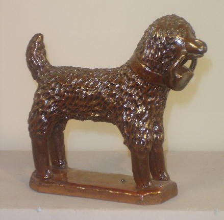 351: PENNSYLVANIA REDWARE DOG. Hand molded dog with too