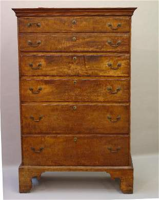 CHIPPENDALE FIVE-DRAWER HIGH CHEST IN CURLY MAPLE.