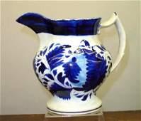 92: GAUDY IRONSTONE PITCHER. Cobalt and medium blue fol