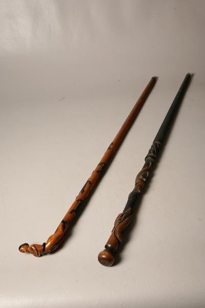 155: TWO FOLK ART CANES. Turn of the 20th Century. One