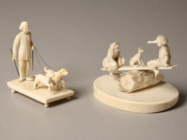 414: TWO IVORY FIGURE GROUPS. European. One of a boy an