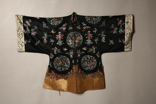 430: EMBROIDERED JACKET. China, ca. 1930. Black silk wi