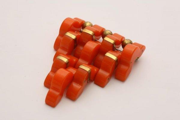1003: GEOMETRIC BAKELITE BROOCH. Orange brooch of ten s
