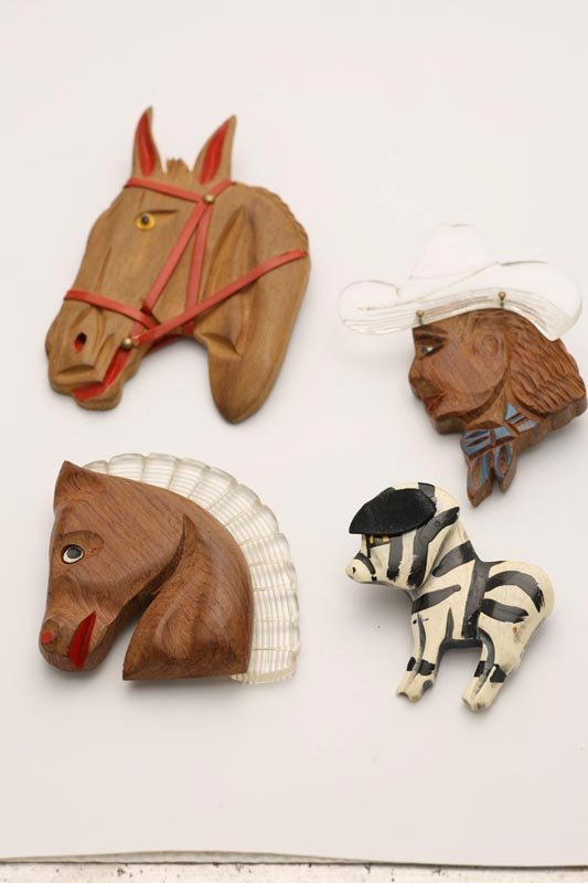 1013: FOUR FIGURAL PINS. Three are carved wood. Horse h