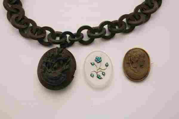 1302: THREE PIECES OF VICTORIAN JEWELRY. Carved gutta p
