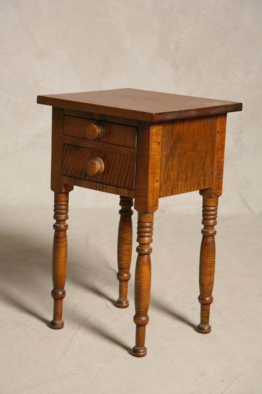 2002: CHILD'S SIZE STAND. Curly maple. Turned legs and