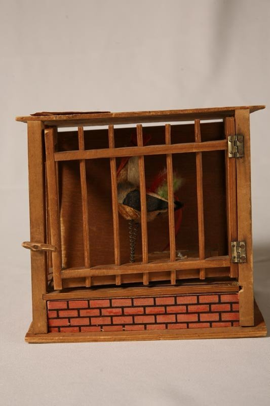 2002B: ROOSTER PIPSQUEAK. Wooden cage with printed shin