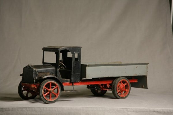"""2005: TOY TRUCK. Black, gray and red paint. Embossed """"W"""