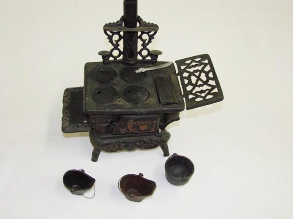"""2008: CAST IRON CRESCENT TOY STOVE. Marked """"Crescent"""" o"""