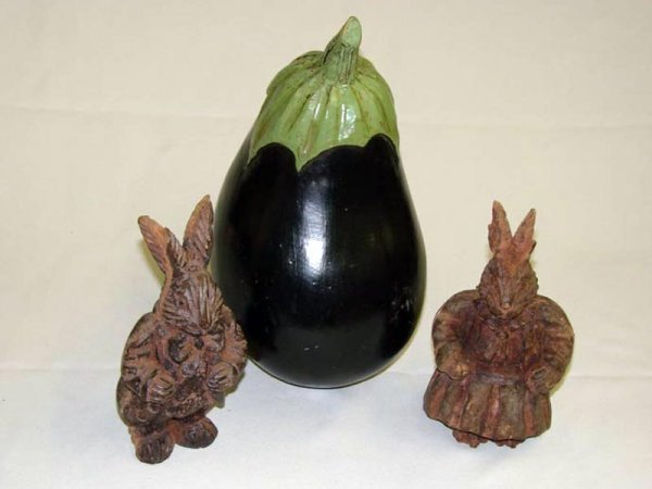 2010: THREE PIECES. Two carved rabbit candy container m