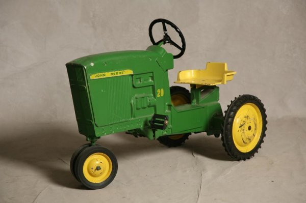 2011: JOHN DEERE TOY RIDING TRACTOR. Green and yellow p
