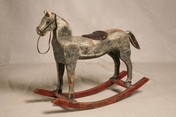 2011A: ROCKING HORSE. Folky carved wooden horse with le