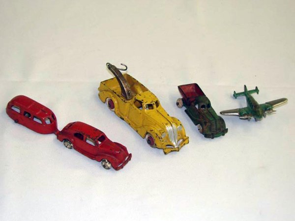 2015: FIVE CAST IRON TOYS. Wrecker, truck, car with tra