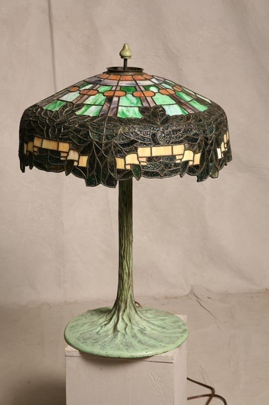2334: LEADED GLASS LAMP. Tiffany bronze base in the for