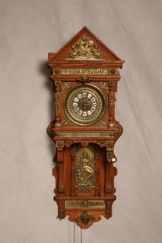 2397: WALL CLOCK. Oak with classical brass applied deco