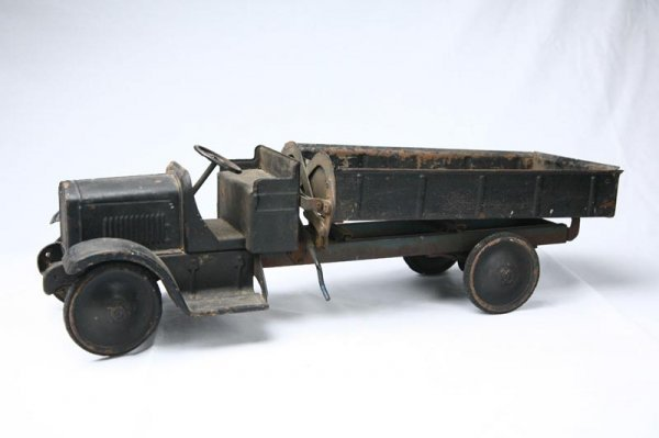"""406: TOY TRUCK. Steel truck with black paint. 27"""" L"""