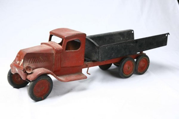 407: TOY TRUCK. Steel truck with red cab and black
