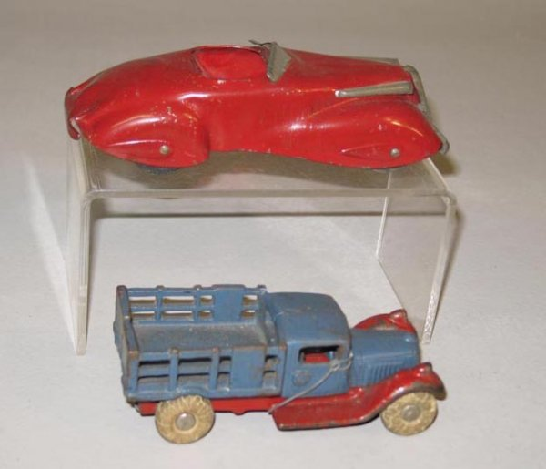 409: TWO TOY CARS. One is a cast iron truck with origin