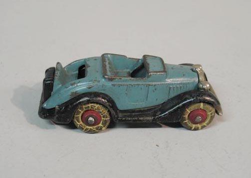411: CAST IRON TOY CAR. Convertible with original light