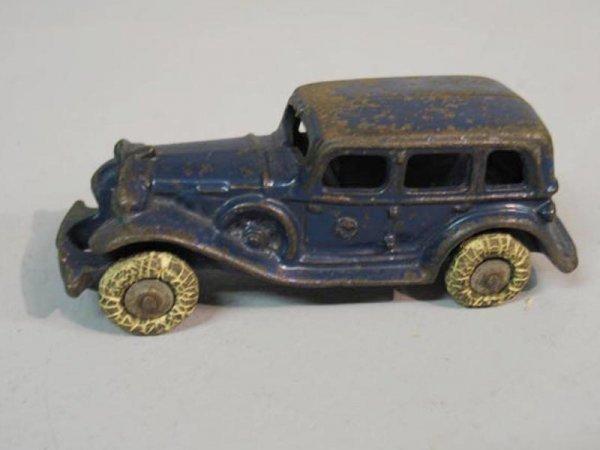 412: CAST IRON TOY CAR. Sedan with original dark blue p