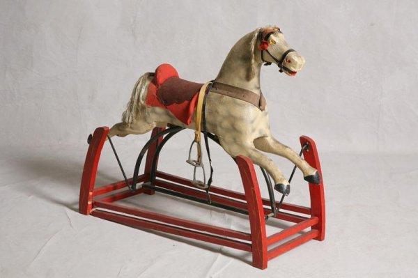 421: ROCKING HORSE. White rocking horse on red base. 31