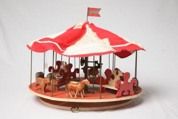 422: CAROUSEL TOY. Electric motor turns carousel with p