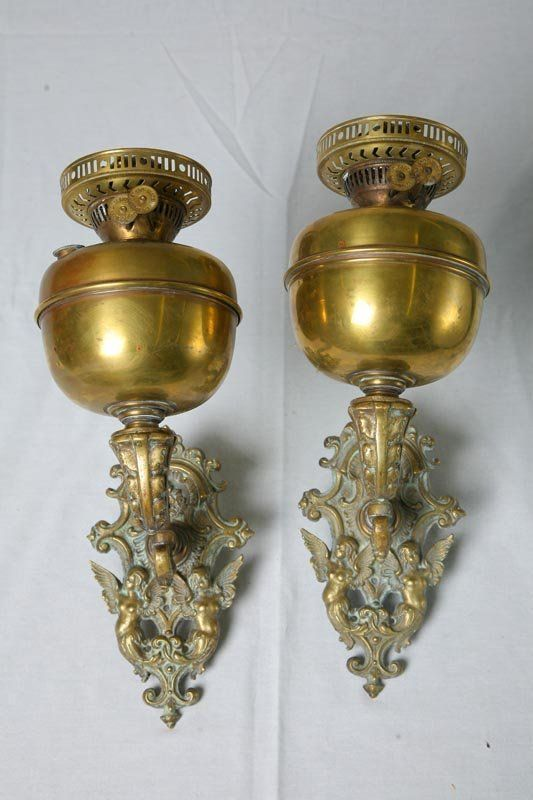 517: PAIR OF ART NOUVEAU BRASS WALL SCONCES. Winged nud