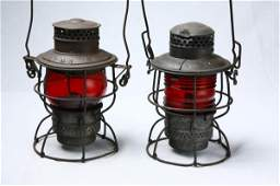 814: TWO RAILROAD LANTERNS. Both have red globes. The g