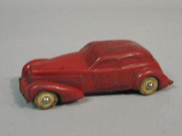 414A: AUBURN RUBBER SEDAN. Red rubber car with original