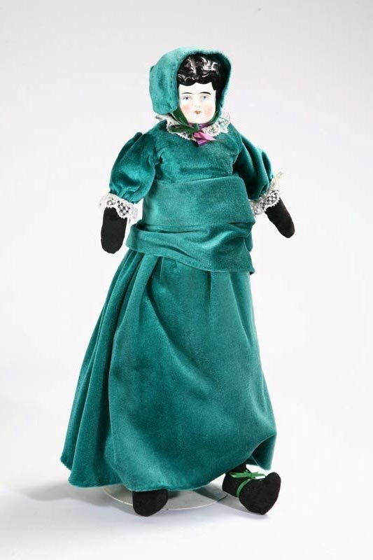 1001: CHINA HEAD DOLL WITH CLOTH BODY. Painted face wit