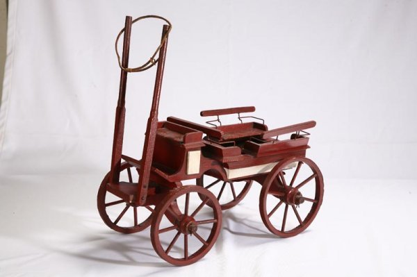 1002: CHILD'S PAINTED WAGON. Red wagon with buck board